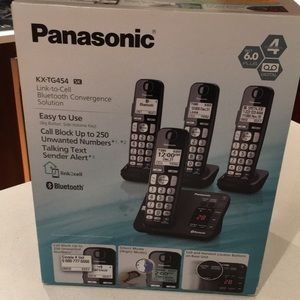 Cordless phone with 4 headsets,box never opened